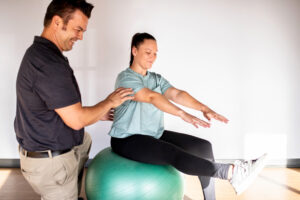 Chris Noda Physical Therapist with patient